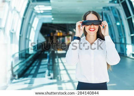 woman wearing goggles in futuristic interior -  wearables concept - stock photo