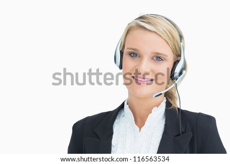 Woman wearing headsets while smiling at the camera