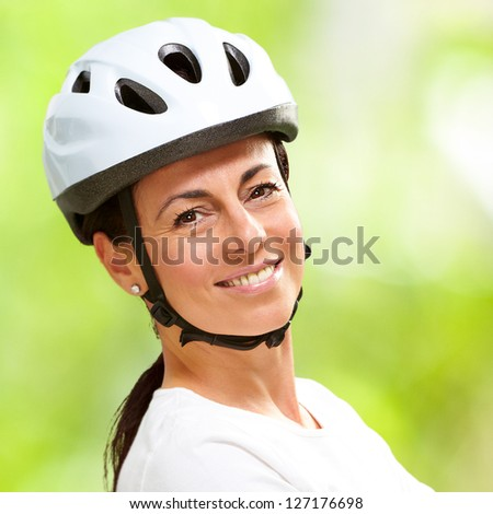 Woman Wearing Helmet With Hands Folded, Outdoor - stock photo