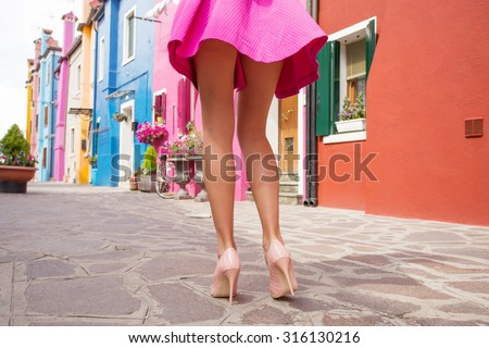 Fashionable Attractive Woman In Miniskirt In City