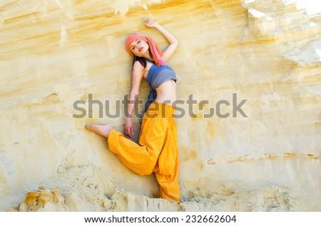 Woman wearing in asian style in desert landscape - stock photo