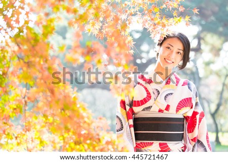 woman wearing japanese traditional kimono in autumn