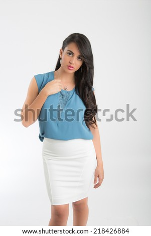 Woman wearing light blue blouse and white skirt - stock photo