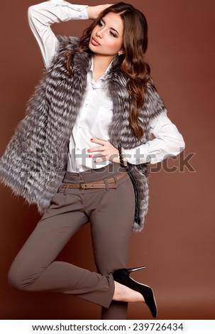 woman wearing luxurious fur coat  - stock photo