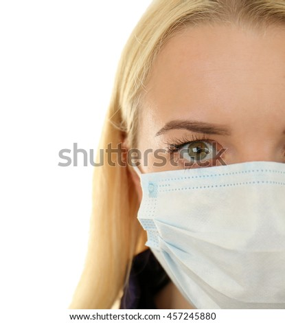 Woman wearing mask isolated on white - stock photo