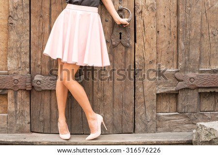 Woman wearing nude colored high heel shoes