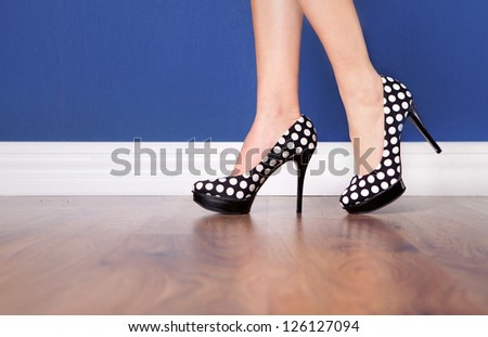 Woman wearing polka dot high heels - stock photo