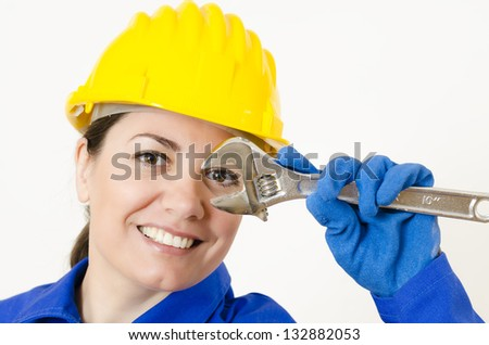 Woman wearing protective equipment holding adjustable wrench