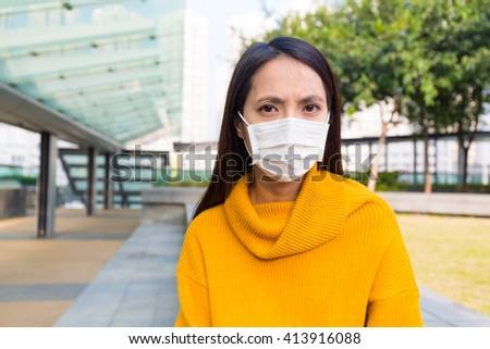 Woman wearing protective mask  - stock photo