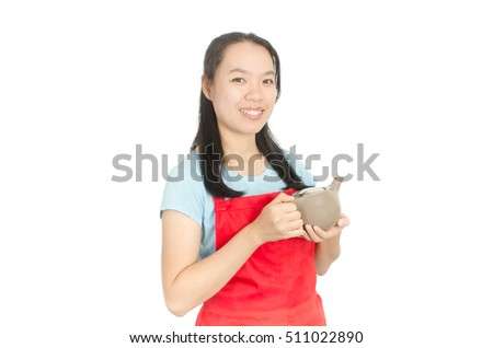 Woman wearing red apron and holding teapot isolated on white background