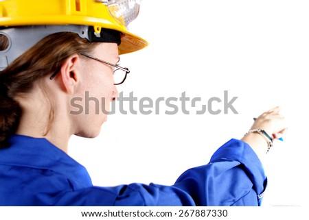 Woman wearing safety helmet - stock photo
