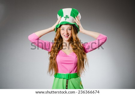 Woman wearing saint patrick hat - stock photo
