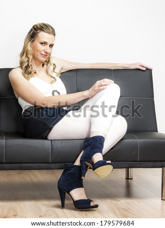 woman wearing summer shoes sitting on sofa