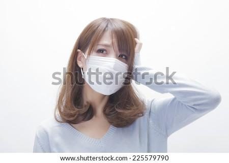 Woman wearing the mask - stock photo