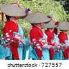 Woman wearing traditional straws hats performing a dance dedicated to a wealthy crop,during a Japanese festival.Miyagi,Japan - stock photo
