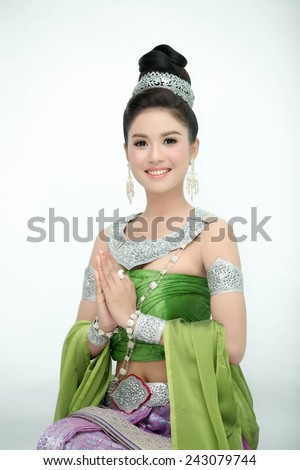 woman wearing typical thai dress, identity culture of thailand - stock photo