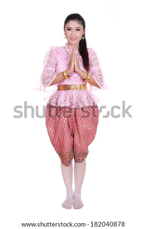 woman wearing typical thai dress pay respect isolated on white background, identity culture of thailand - stock photo