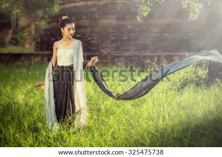 Woman wearing typical thai dress with thai identity culture of thailand - stock photo