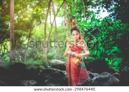 woman wearing typical thai dress with thai style - stock photo