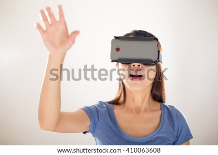 Woman wearing vr device - stock photo