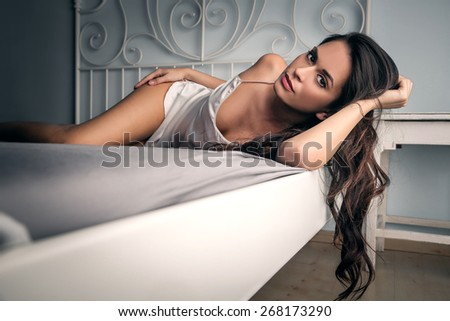 Woman wearing white lingerie  - stock photo