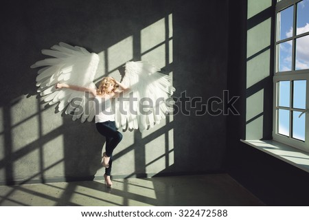 Woman White Angel on Background - stock photo
