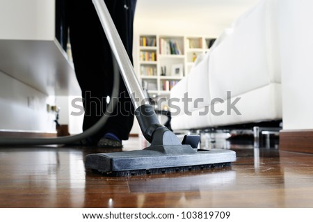 woman who cleans the floor of the house