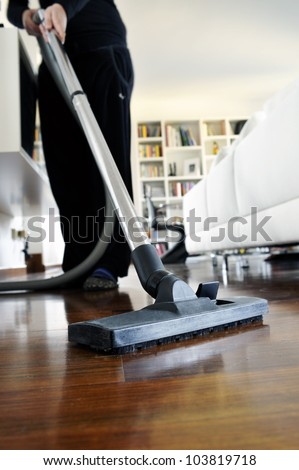 woman who cleans the floor of the house - stock photo