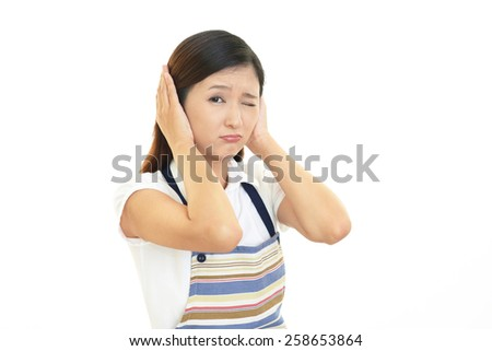 Woman who closes her ears - stock photo