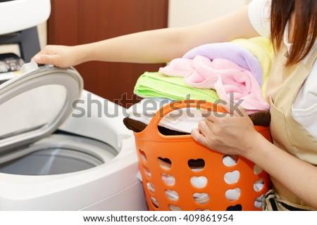 Woman who do the washing - stock photo