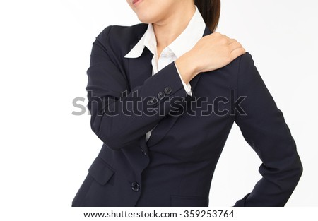 Woman who has a shoulder pain. - stock photo