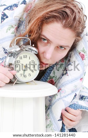 Woman who hates her alarm clock - stock photo
