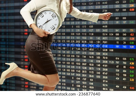 woman who is appointed to be competitive with stock graph report - stock photo