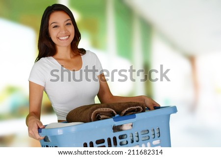 Woman who is doing laundry in her home - stock photo