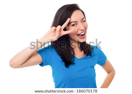 Woman winking and holding her hand over her eyes - stock photo