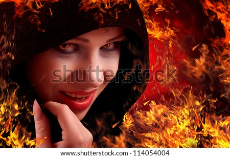 woman witch on fire, Halloween - stock photo