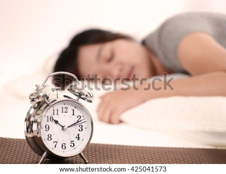 woman with a  alarm clock