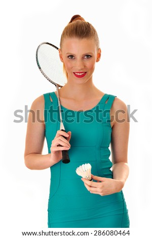 Woman with a badminton racket and a shuttle. - stock photo