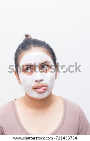 Woman with a beauty mask on her face at home.