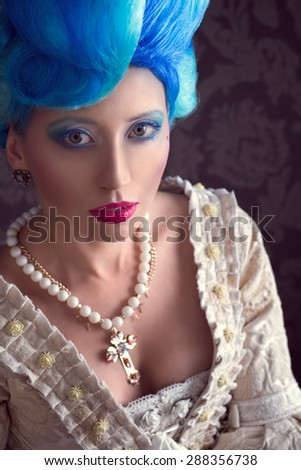 Woman with a big wig and baroque dress - stock photo