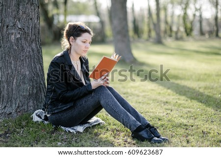 Woman with a book in spring park