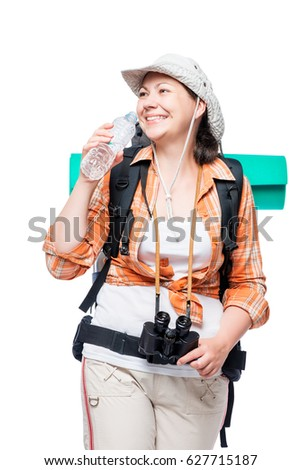 woman with a bottle of water and a heavy backpack on a white background