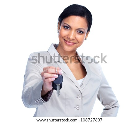 Woman with a car keys. Isolated on white.