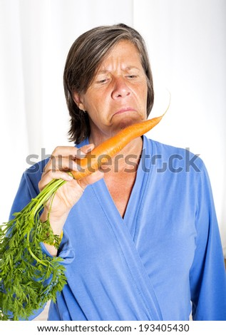 woman with a carrot in her mouth looking angry
