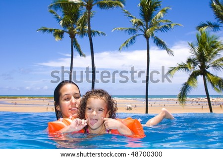 Woman with a child in the pool .