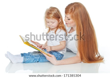 Woman with a child reading a book - stock photo