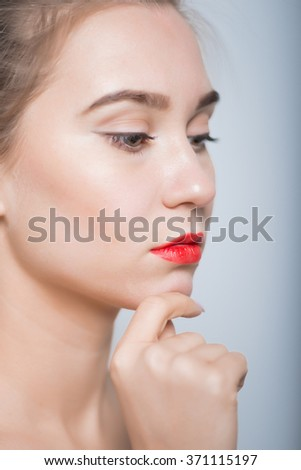 Woman with a clean face with make-up and red lipstick