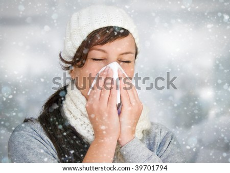 woman with a cold holding a tissue - it's snowing