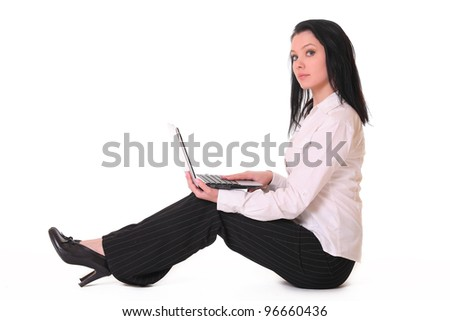 Woman with a computer smiling - isolated over a white background