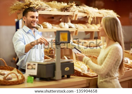 Woman with a credit card at the counter - stock photo